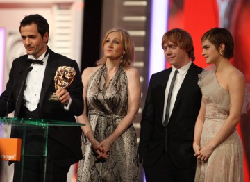 On stage at the 2011 Orange British Academy Film Awards; J.K. Rowling, David Heyman, Emma Watson and Rupert Grint.