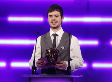 The newest Blue Peter cohort and CBBC man Barney Harwood steps up to present the Family award. (Pic: BAFTA/Brian Ritchie)