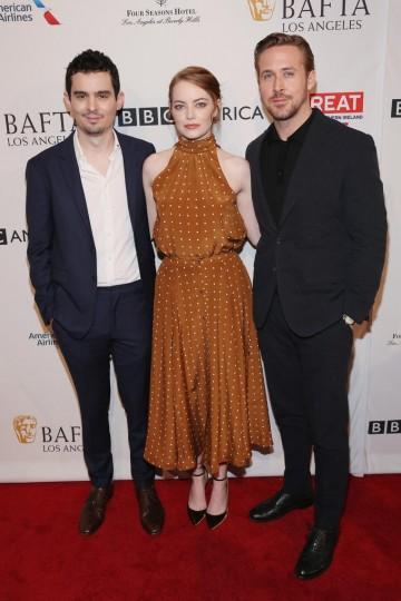 La La Land stars Emma Stone and Ryan Gosling pose with Director Damien Chazelle on the 2017 BAFTA Tea red carpet