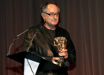 Wolf's son and fellow cinematographer Peter Suschitzky, prepares to present his father with the BAFTA Award.