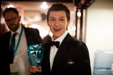 Tom Holland celebrates his win