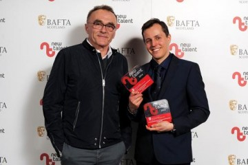Kris Kubik - Winner in the Camera/Photography and Best New Work categories with presenter Danny Boyle