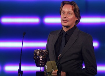 The award-winning games composer and sound designer announces the winner of Original Music. (Pic: BAFTA/Brian Ritchie)