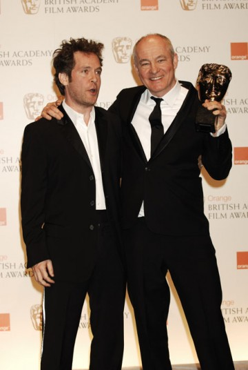 Barry Ackroyd hugs in The Loop's Tom Hollander after winning best Cinematography award for The Hurt Locker (BAFTA/Richard Kendal).