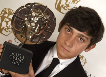 Best Actor winner for his role in Submarine, Craig Roberts poses with his BAFTA Cymru Award