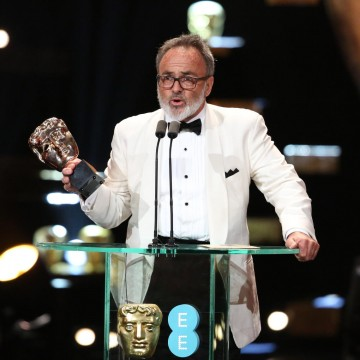 Colin Gibson, production designer on Mad Max: Fury Road, accepts the award for Production Design at the 2016 EE British Academy Film Awards