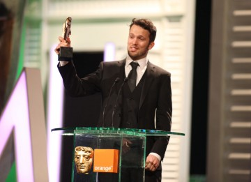 Michael Please accepts the BAFTA for his animation The Eagleman Stag. (Pic: BAFTA/Stephen Butler)