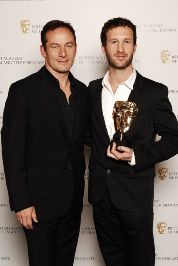 The Fallen director Morgan Matthews celebrates winning the Director Factual BAFTA with Harry Potter star Jason Isaacs (BAFTA / Richard Kendal).