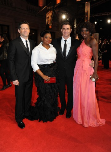 The Help producer Brunson Green, actress Octavia Spencer, director Tate Taylor and actress Viola Davis. The film is nominated for five BAFTAs including Best Film, Leading Actress and Supporting Actress. Davis is wearing a dress by Valentino, shoes by Jimm