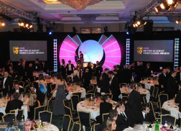 Guests settle down to a sumptuous three-course dinner in the Ballroom at the London HIlton Hotel (BAFTA / James Kennedy).