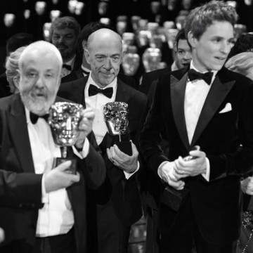 Mike Leigh, J.K. Simmons and Eddie Redmayne line up with their awards at the winners' photo call.