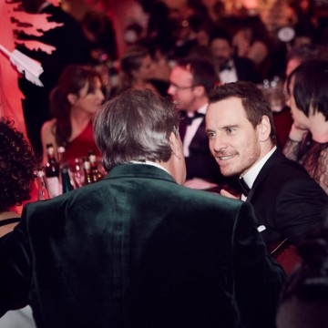 Host Stephen Fry and Michael Fassbender deep in conversation at London's Grosvenor House