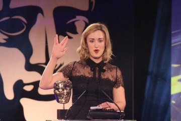 Ashley Johnson accepts the award for Performer at the British Academy Games Awards in 2015