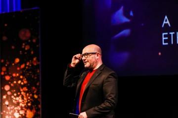 Host Boyd Hilton introduces Ethan Hawke to the stage