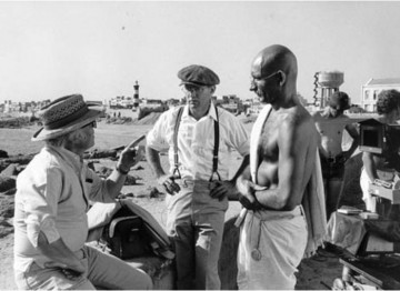 Producer/Director Richard Attenborough talks to actor Ben Kingsley on location in India
