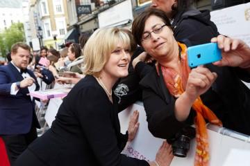 Leading Actress nominee Sarah Lancashire meets a fan outside London's Theatre Royal