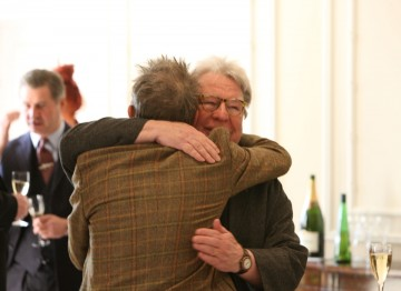 John Hurt greets Alan Parker. The two worked together on Midnight Express which Parker directed in 1978.