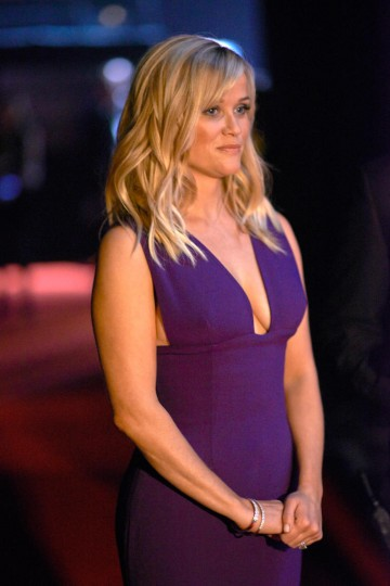 Leading Actress nominee and Supporting Actor presenter Reese Witherspoon poses backstage at London's Royal Opera House.