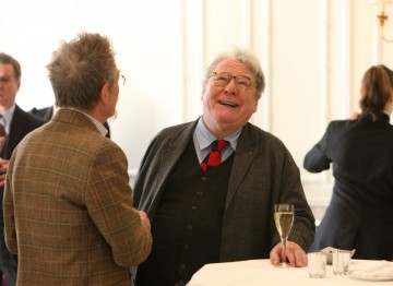 Actor John Hurt catching up with Alan Parker at Savoy, London.
