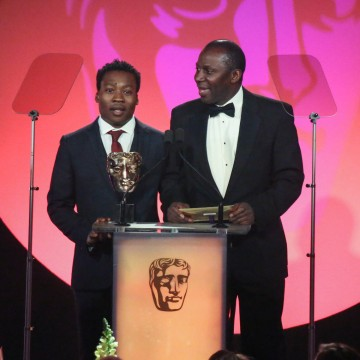 Fisayo Akinade and Cyril Nri present the award for Titles & Graphic Identity at the British Academy Television Craft Awards in 2015