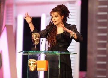 "Helena Bonham Carter accepts the BAFTA for her role in The King's Speech. ""I am thrilled to be considered in the same category as my fellow supporting actresses, and I am not just sucking up: you are all brilliant."" (Pic: BAFTA/ Stephen Butler)"