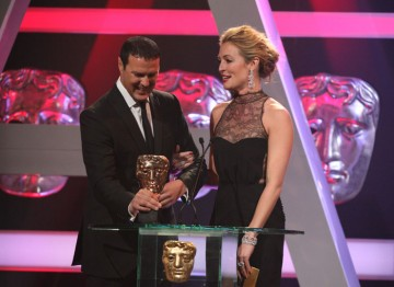 Paddy McGuinness and Cat Deeley announce the winner of the Continuing Drama category.