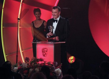 Peter Bawker accepts the Writer award for Eric and Ernie, a comedy drama about the making of legendary double-act Morecambe and Wise. {Pic: BAFTA/Jamie Simonds)