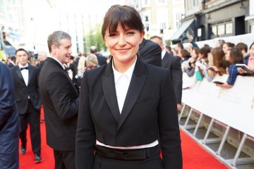 Davina McCall arrives on the red carpet. Dress by House of Fraser, hair by Mark Hill.