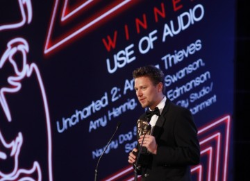 Christophe Balestra accepts the second award of the eventing for Uncharted 2: Among Thieves, winner in the Use of Audio category (BAFTA/Brian Ritchie)