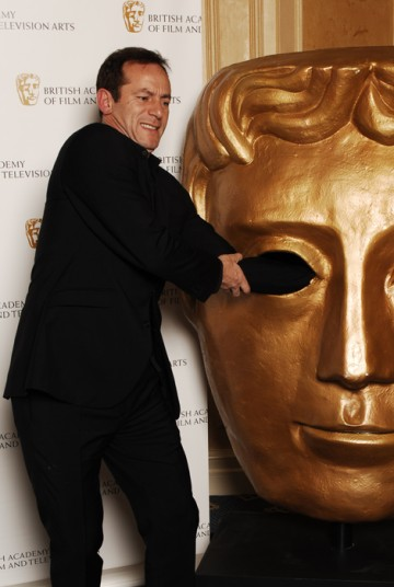 Jason Isaacs has run-in with the BAFTA mask (BAFTA / Richard Kendal).
