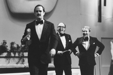John Cleese collects a Best Light Entertainment Performance BAFTA for 'Fawlty Towers' from comedy duo Eric Morcambe and Ernie Wise.
