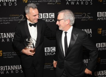 Daniel Day-Lewis enjoys a moment with Steven Spielberg, backstage at the 2012 Britannia Awards.