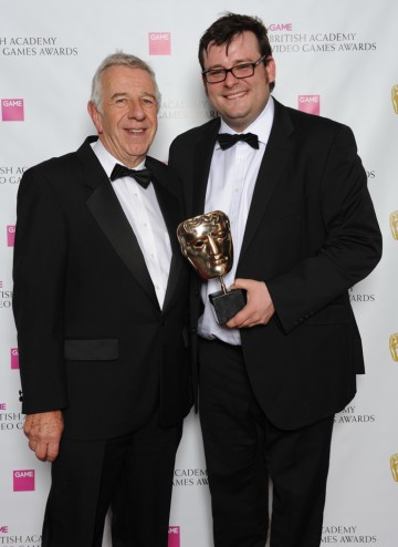 "Presenter Geoff Heath OBE and Kevin Flynn of Electronic Arts. The jury described the game as excelling at ""delivering unprecedented levels of player teamwork and roles in a vast, gripping environment."""