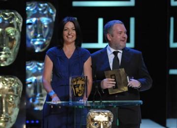 Egged on by Davina McCall, Radio DJ Chris Moyles impersonates comedian Michael McIntyre before the pair presented the Philips Audience Award - the only award of the night voted for by the public (BAFTA / Marc Hoberman).