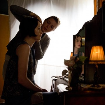 Michelle Dockery,who plays Lady Mary Crawley in the series, has her hair touched up in between takes.