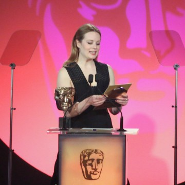 Cara Theobold presents the award for Photography & Lighting: Fiction at the British Academy Television Craft Awards in 2015