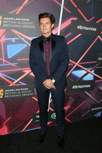 British actor and humanitarian Orlando Bloom poses on the red carpet ahead of the ceremony.
