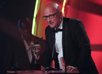 Dan Reed accepts the award for Director: Factual for Dispatches: The Battle For Haiti at the 2011 TV Craft Awards. (Pic: BAFTA/Jamie Simonds)