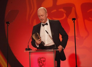 Dan Jones accepts the award for his music composed to accompany the four part television series, Any Human Heart. (Pic: BAFTA/Jamie Simonds)