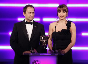 The Hollyoaks actress and Command & Conquer: Red Alert 3 voice artist teams up with Ben 'The Stig' Collins to present the first award of the evening. (Pic: BAFTA/Brian Ritchie)