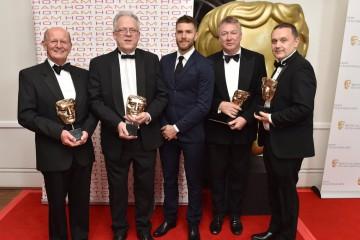Winners of Entertainment Craft Team, Bernie Davis, David Cole, Kevin Duff and Patrick Doherty, for Royal British Legion with presenter Joel Dommett