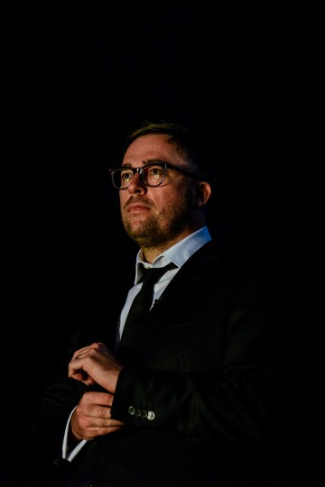 Danny Wallace watches off stage