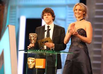 Jesse Eisenberg (The Social Network) and Jennifer Lawrence (Winter's Bone) announce the Special Visual Effects winner. (Pic: BAFTA/ Stephen Butler)