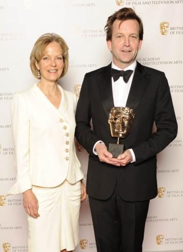 Director Philip Martin celebrates his BAFTA win for Mo with award presenter Jenny Seagrove.