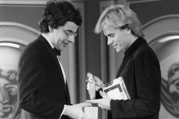 Sting presents comedian Rowan Atkinson with the Best Light Entertainment Performance BAFTA for 'Not the Nine O'Clock News'.
