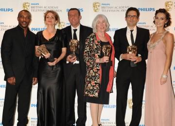 Kara Tointon and Ashley Walters presented the Drama Serial BAFTA to the production team behind Any Human Heart: Lynn Horsford, Lee Morris, Sally Woodward Gentle and Michael Samuels. (Pic: BAFTA/Richard Kendal)