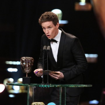 Eddie Redmayne presents the award for Supporting Actress at the 2016 EE British Academy Film Awards