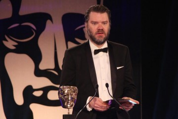 Chet Faliszek presents the award for Game Innovation at the British Academy Games Awards in 2015
