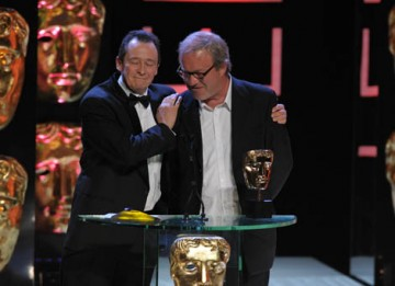 Comedy duo Harry Enfield and Paul Whitehouse celebrate winning the Comedy Programme award for their eponymous sketch show Harry & Paul (BAFTA / Marc Hoberman).