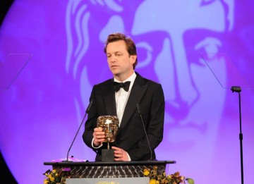 Philip Martin completes a hat-trick of mask for Mo as he collects the Director Fiction BAFTA.